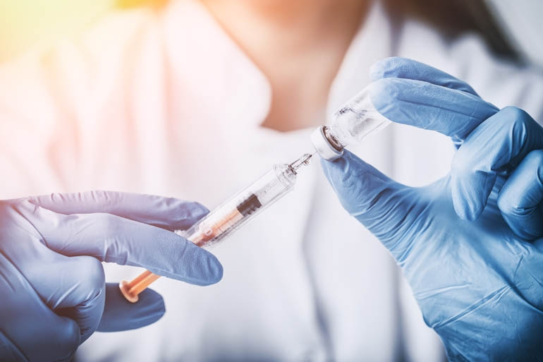 Flu vaccine and syringe