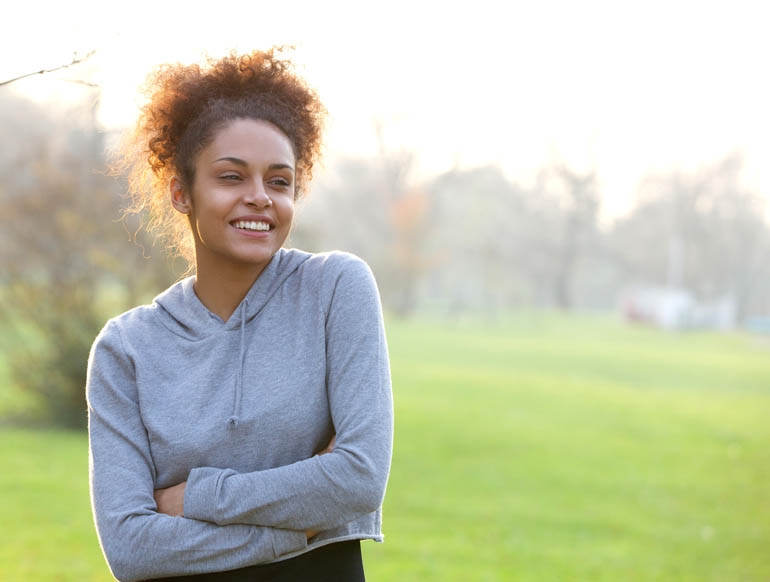 healthy woman standing in a park