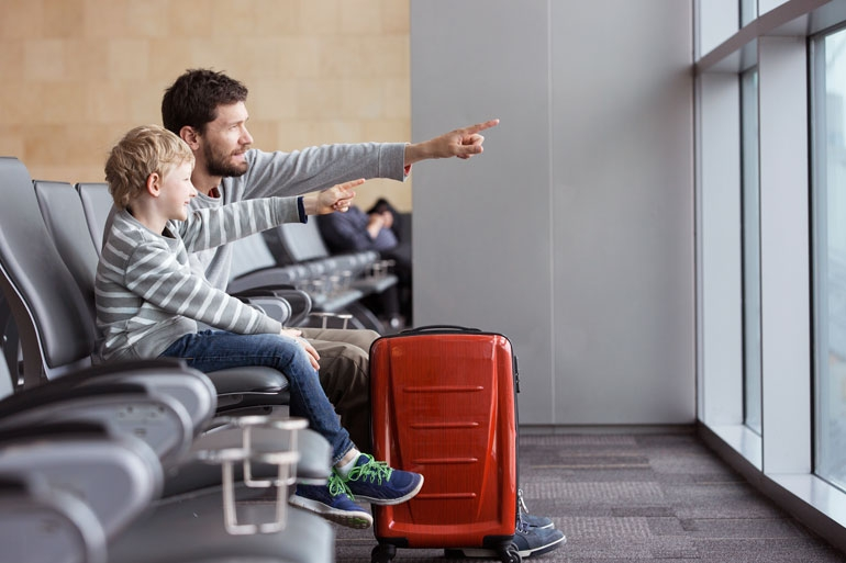 Father and Son happily waiting to board an airplane