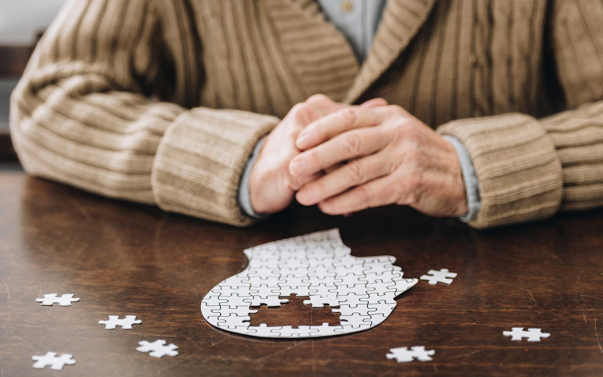 Senior man playing with puzzles