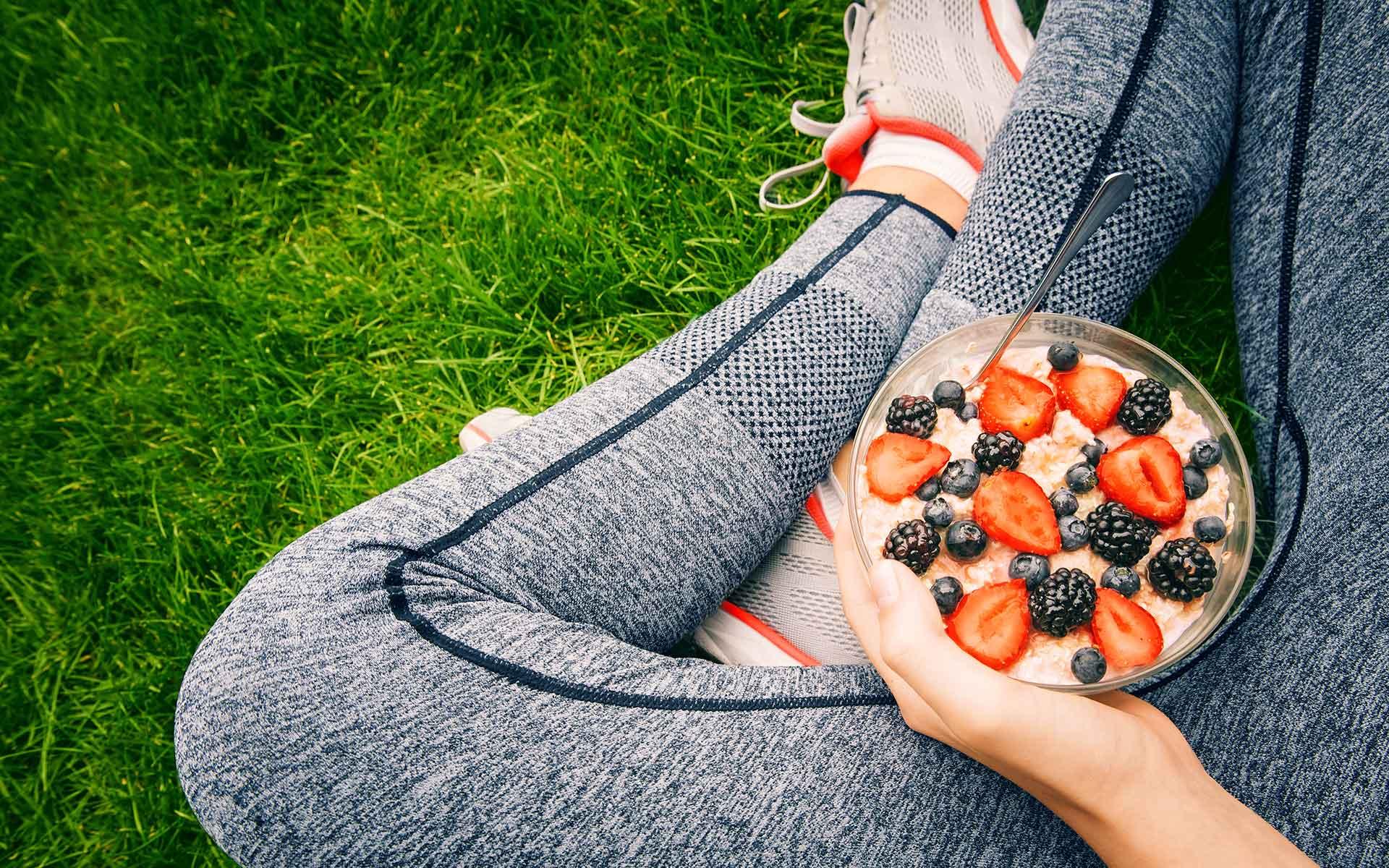 Girl eating porridge with berries