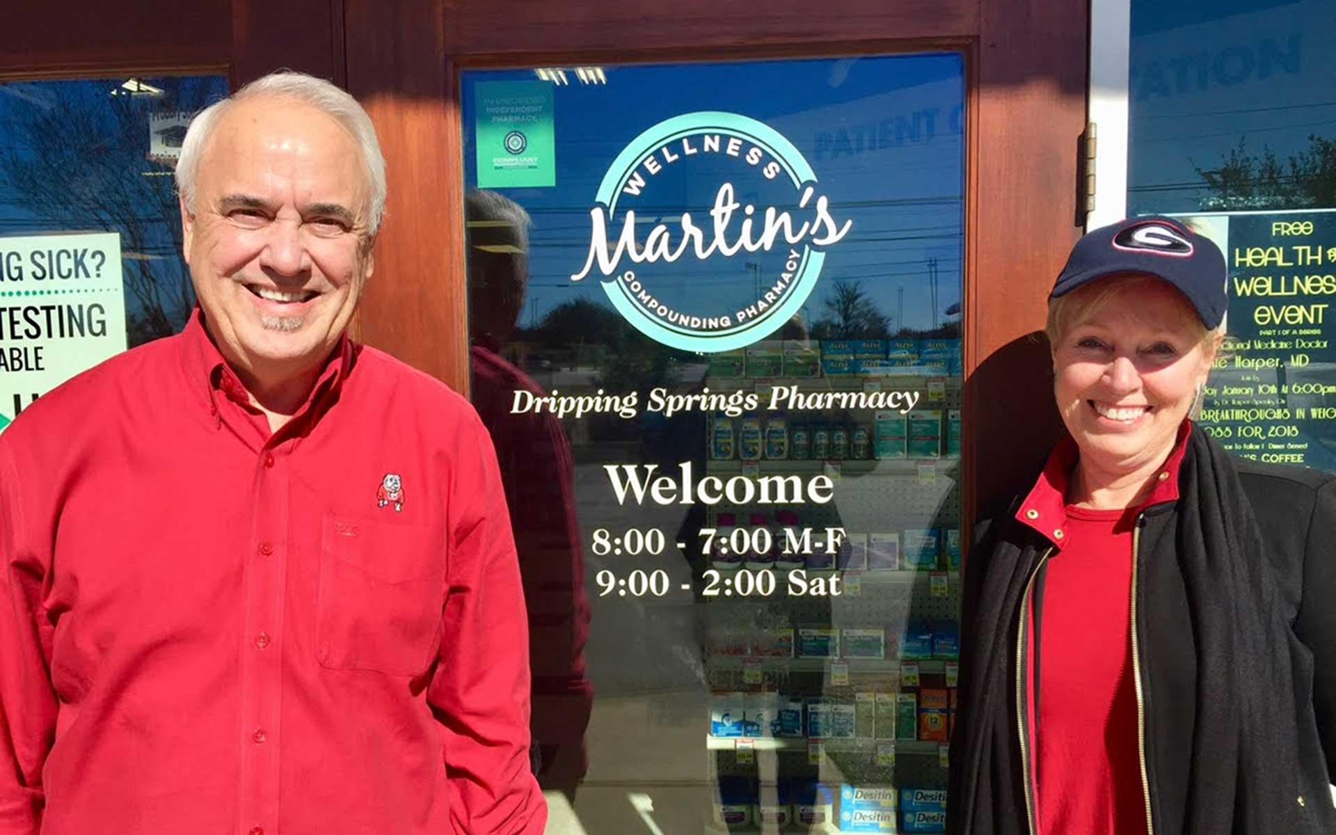 Jim and Dorinda in front of the pharmacy