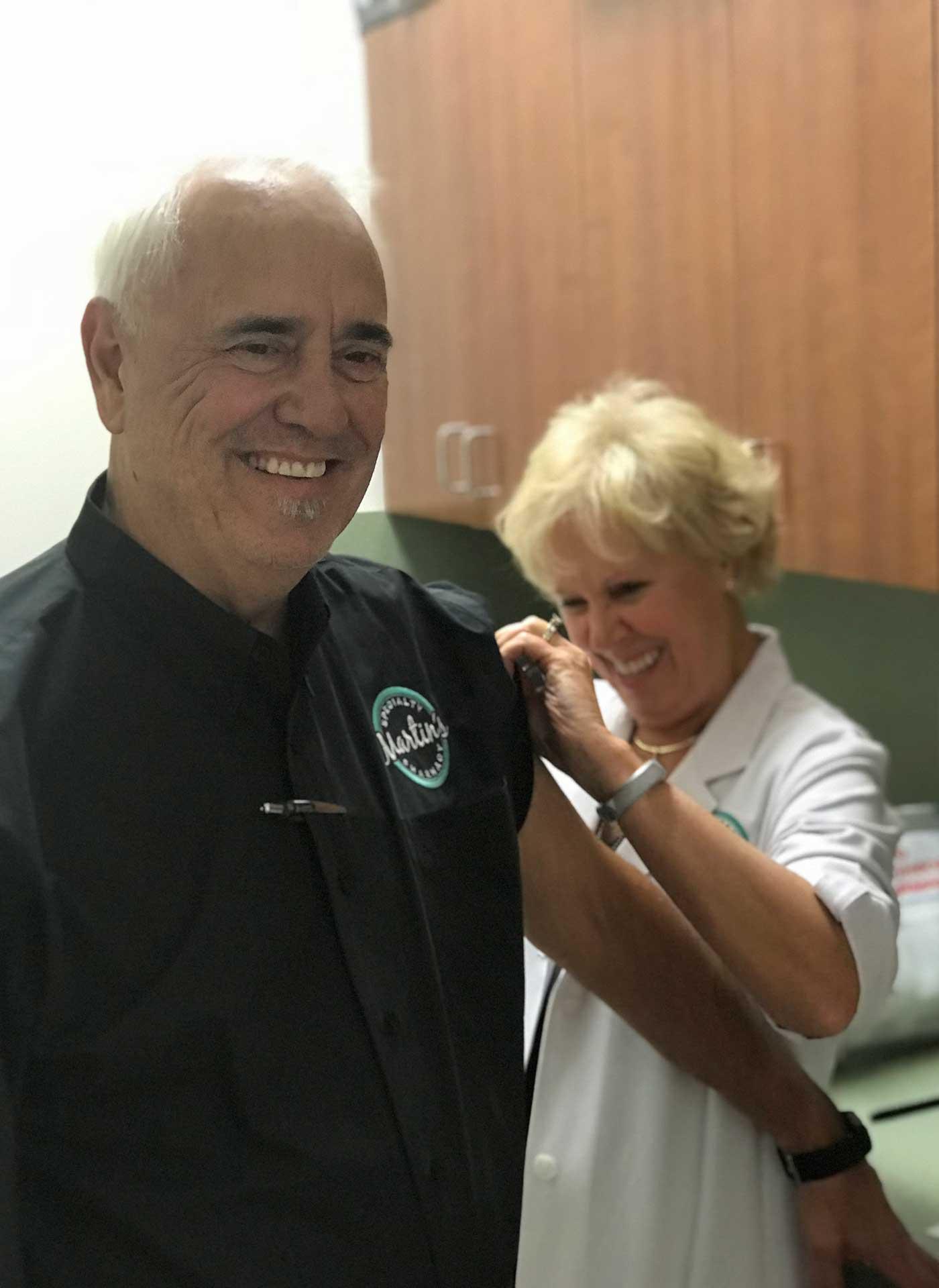 Dorinda vaccinating Jim