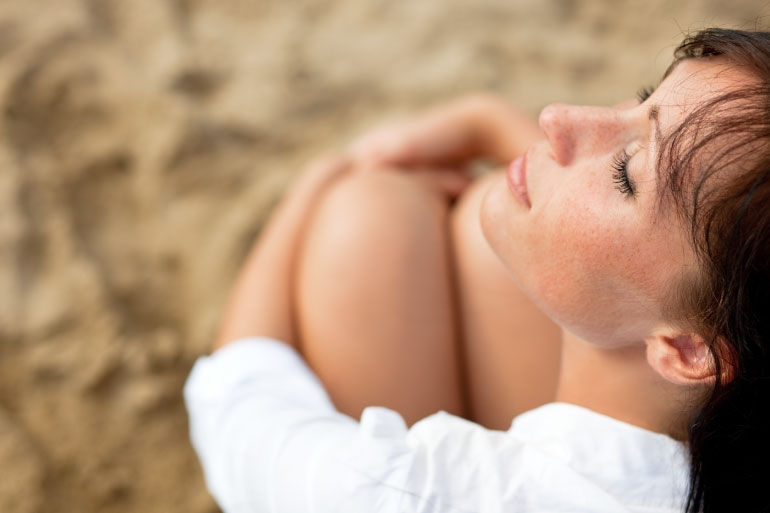 A woman looking content due to feel-good GABA neurotransmitters