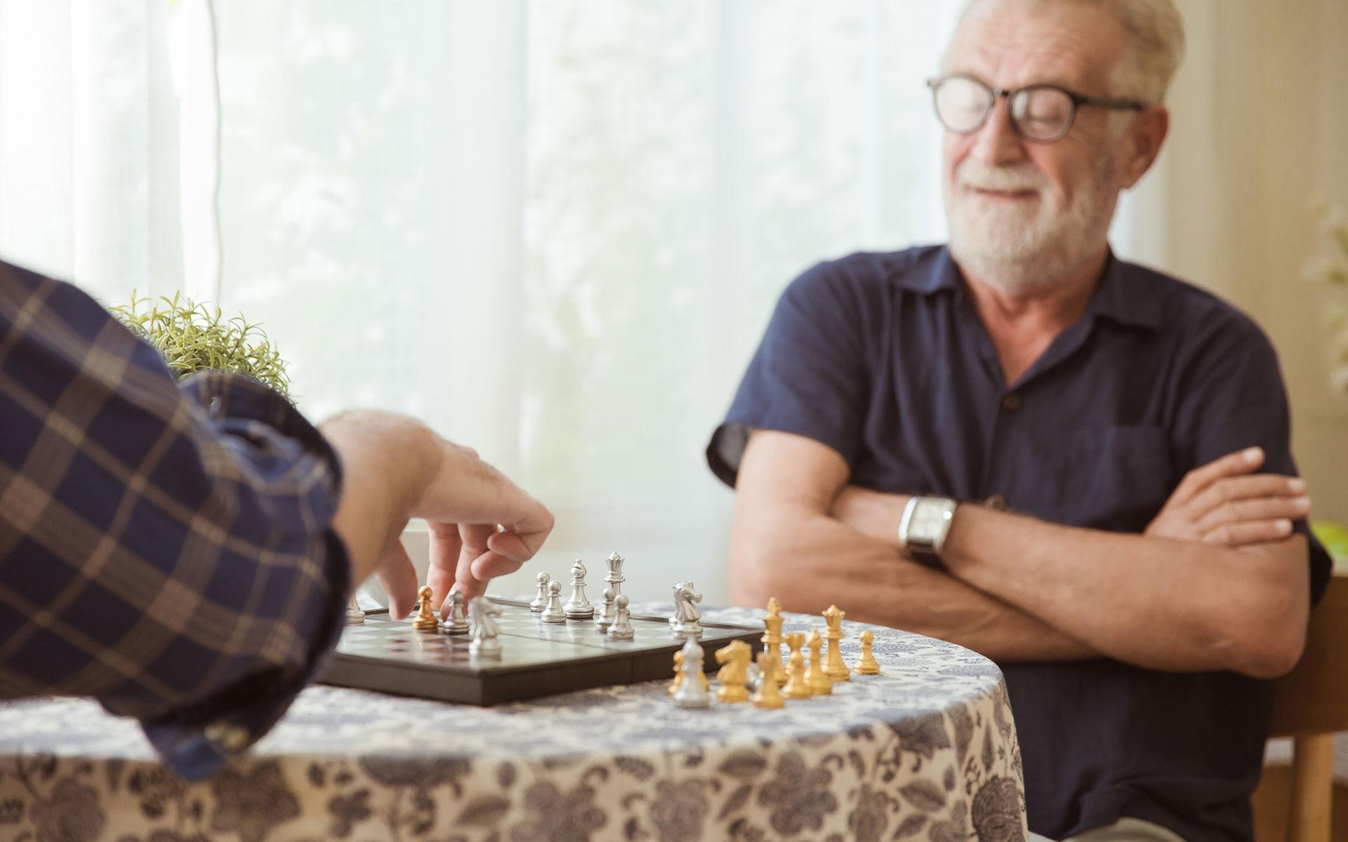 Elderly man enjoying a game of chess