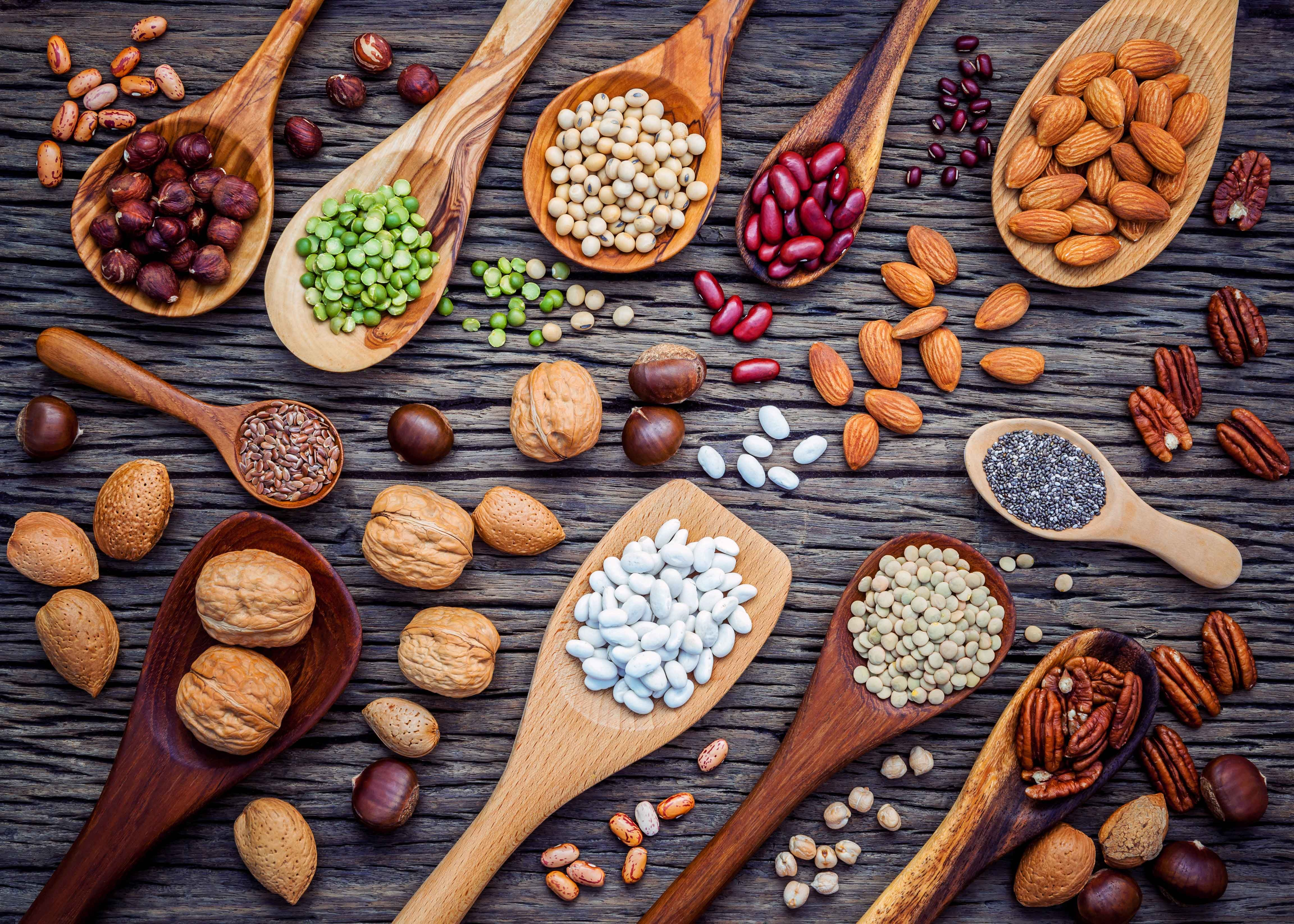 Wooden spoons filled with a variety of seeds and nuts rich in  omega 3 6 9 fatty acids